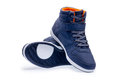 Pair of high top fashion blue sneakers Royalty Free Stock Photo