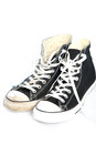 Pair lace up sneakers trainers black canvas white laces white background Stock Photos