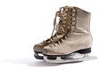 Pair of ladies white ice skates with steel blades and their laces done up in side view on a background with shadow and Royalty Free Stock Photos