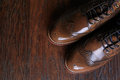 A pair of luxury brown shoes close up on wood background Stock Photo
