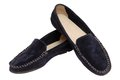 Pair of moccasins shammy on white Stock Images