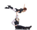 Pair of modern dancers posing in acrobatic pose isolated on white Royalty Free Stock Photo