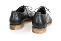 Pair of new black leather shoes on the white background rear view Stock Photography