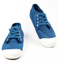 A pair of new blue shoes on white background Stock Photo