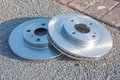 Pair of new car brake disks ready to be fitted Royalty Free Stock Photos