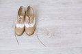 Pair of new shoes unlaced womans on a white wooden floor Stock Image