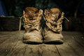 Pair of old boots on wooden floor boards Royalty Free Stock Photo