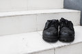 Pair of old dirty work boots Royalty Free Stock Photo