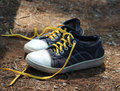 Pair of old retro sneakers with yellow shoelaces Stock Photography