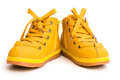 Pair of orange shoes for kid on white background Stock Photo