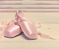 Pair of a pale pink ballet point shoes or slippers on white background with copy space Stock Photos