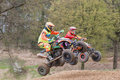 Pair of quad riders are jumping in the race Royalty Free Stock Photo
