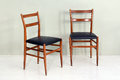Pair of Retro Kitchen Chairs with Wood Legs Royalty Free Stock Photo