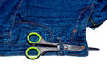 Pair of scissors and blue jeans and zipper isolated on white background Royalty Free Stock Photo