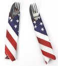 Pair of silverware wrapped in American flag napkins Royalty Free Stock Photo
