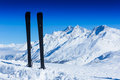 Pair of skis in snow winter vacations european alps Stock Photos