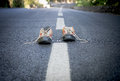 Pair of sneakers on the road Royalty Free Stock Photo