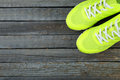 Pair of sport shoes on blue wooden background Royalty Free Stock Images