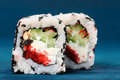 Pair of square sushi rolls with vegs, cream cheese and red roe o Royalty Free Stock Photo