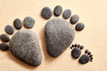 Pair of stones in the shape of human feet Royalty Free Stock Photo