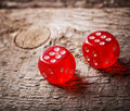 Pair of thrown red dices on wooden table old Stock Image