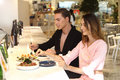 A pair of trendy lovers having dinner in fusion restaurant Royalty Free Stock Photo