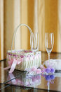 A pair of wedding glasses, basket and a pillow Stock Images