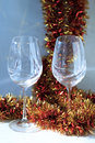 Pair of wine glasses with beautiful golden and red festive decoration on the homogeneous background Royalty Free Stock Photo