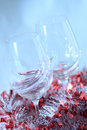 Pair of wine glasses in diagonal with beautiful white and red festive decoration on the homogeneous background Royalty Free Stock Images
