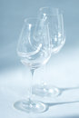 Pair of wine glasses in diagonal close up zoom view empty on the homogeneous background creating clear and pure monochromatic Royalty Free Stock Images