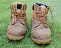 A pair of work boots on grass Stock Images