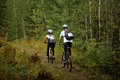 Pair of young cyclists Royalty Free Stock Photo