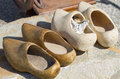 Pairs of old wooden clogs vintage at fle market Stock Photo