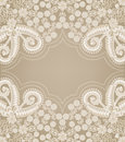 Paisley pattern with figured gray frame in the center on a beige background Stock Photo
