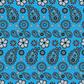 Paisley stile pattern on blue background Stock Images