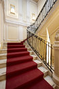 Palace entrance and marble stairway interior with red carpet on a Royalty Free Stock Photography