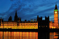 Palace of westminster london at night uk floodlit reflections in river Royalty Free Stock Images