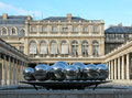Palais royal in paris pol bury s steel ball sculpture at france Stock Image
