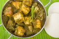 Palak paneer south asian curry made with cheese with pureed spinach sauce served with idlis Royalty Free Stock Images