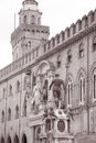 Palazzo comunale palace and neptune fountain fontana del nett nettuno bologna italy in black white sepia tone Stock Photography