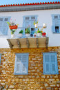 Blue Window Shutters on Stone House Royalty Free Stock Photo