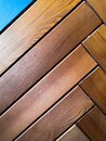 Pale faded brown and cool blue reclaimed wood surface with aged boards lined up. Wooden planks Royalty Free Stock Photo