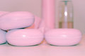 Pale pink soaps, soft light. Royalty Free Stock Photo