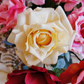 Pale white fake rose flower