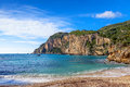 Paleokastritsa beach and cliffs a section of a popular tourist destination on corfu island greece Stock Photo