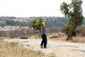 Palestinian protester shooting rock at protest bil in palestine may th a using his slingshot to shoot a the soldiers on the other Stock Images