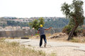 Palestinian protester shooting rock at protest bil in palestine may th a using his slingshot to shoot a the soldiers on the other Royalty Free Stock Images