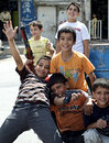 Palestinian refugee boys playing outdoors in a camp in jordan Royalty Free Stock Photos