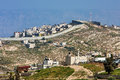 Palestinian town behind separation wall in Israel. Royalty Free Stock Photo
