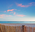 Palisade at sunset beach under a scenic evening sky Royalty Free Stock Photography
